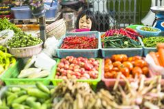 Girl child seller on the Burmese street market in Bangkok. Stock Photography