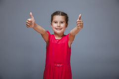 The girl child is showing thumbs up gesture yes on Royalty Free Stock Photos