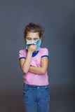 The girl child is sick in hands handkerchief on Stock Photography