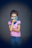 The girl child is sick in hands handkerchief on Stock Photo