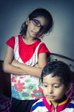 Girl child standing with folded hands with his brother Royalty Free Stock Photo