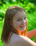 Girl child summer. Portrait of a smiling young girl in summer Royalty Free Stock Photography