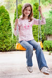 Girl child at swing chair Royalty Free Stock Photo