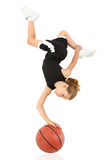 Girl Child Upsidedown Balancing on Basketball Stock Photography