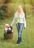 Girl and child in valise royalty free stock images