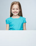 Girl child with white board. Isolated portrait. Royalty Free Stock Images