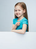 Girl child with white board. Isolated portrait. Royalty Free Stock Photos