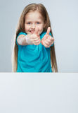 Girl child with white board. Isolated portrait.Thumb up. Stock Photography