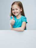 Girl child with white board. Isolated portrait.Thumb up. Stock Image