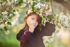 Girl child in wreath of flowers, spring flowers stock photo