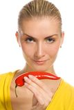 Girl with chili pepper Stock Photos