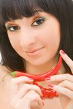 Girl with chili pepper. Cute girl with chili pepper stock photos