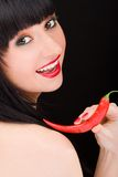 Girl with chili pepper Royalty Free Stock Image