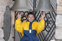 Girl chiming on the bells Royalty Free Stock Photography