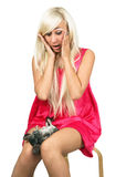 A girl and a chinchilla. Blonde scared when chinchilla fell asleep royalty free stock photos