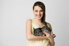 Girl with chinchillas Stock Photography