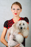 Girl and chinese crested dog. The beautiful girl and chinese crested dog on grey background. Shallow DOF stock photos