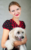Girl and chinese crested dog. The beautiful girl and chinese crested dog on grey background. Shallow DOF, focus on dog stock photography