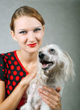 Girl and chinese crested dog. The beautiful girl and chinese crested dog on grey background. Shallow DOF, focus on dog royalty free stock photography