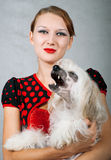 Girl and chinese crested dog. The beautiful girl and chinese crested dog on grey background. Shallow DOF royalty free stock images
