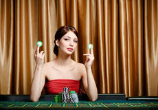 Girl with chips at the casino table Stock Images