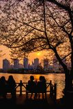 Girl Chit-chat with beautiful sunset view of Seokchon lake royalty free stock image
