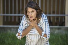 Girl chocking during feeding. Girl searching help while she& x27;s choking during feeding Stock Image