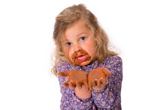 Girl with chocolat on hands Royalty Free Stock Image