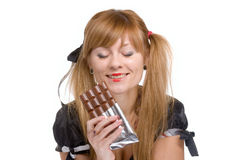 The girl and chocolate Royalty Free Stock Photos