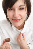 Girl with chocolate. Smiling girl holding a piece of chocolate in hand Stock Photo