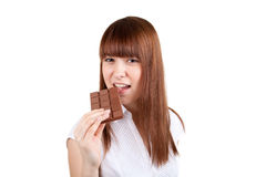 The girl with a chocolate. The beautiful girl with a chocolate Stock Image