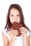 Girl and chocolate Stock Image