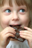 Girl with chocolate Stock Photos
