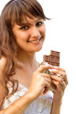 Girl with chocolate. Young beautiful woman holds taken bite chocolate piece, is isolated on white background Stock Photography