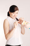 Girl and chocolate bar Royalty Free Stock Image
