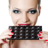 The girl with a chocolate bar Royalty Free Stock Photos