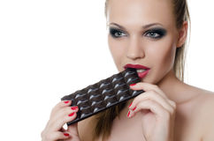 The girl with a chocolate bar Royalty Free Stock Image
