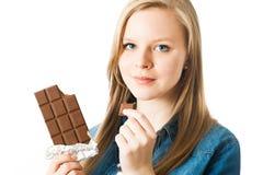 Girl with chocolate Stock Photos