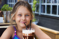 Girl and chocolate cocktail Stock Photography