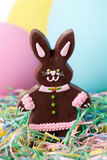 Chocolate Easter bunny girl. A girl chocolate Easter bunny with craft eggs and shredded paper Stock Photography