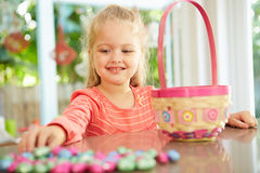 Girl With Chocolate Easter Eggs And Basket At Home Stock Image