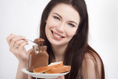 Girl with chocolate spread Stock Image