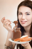 Girl with chocolate spread. Girl with a jar of chocolate spread Royalty Free Stock Image