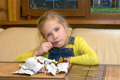 Girl with chocolates. Royalty Free Stock Photography