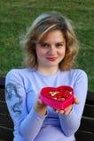 Girl with chocolates box stock photos
