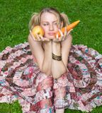 Girl choices between vegetable and fruit stock images