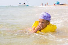 Girl choked and hit the water in the nose, while she was bathing in the sea Stock Images