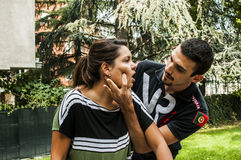 Girl is choking. Guy helping a girl while choking Stock Photos