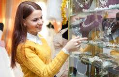 Girl chooses bridal accessories Stock Images