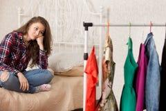 Girl chooses dresses Stock Images